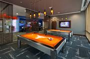 The game room at Callaway House is designed with the University of Texas Longhorn teams in mind.