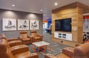 Comfortable seating and a widescreen television makes the game room an appealing choice for socializing. The artwork of Austin artists is displayed throughout the residence hall.