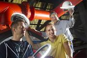 From left, Illumagear President, co-founder and Chief Product Officer Andrew Royal, Max Baker, CEO and Co-Founder, and John Manthey, VP of Engineering. TechFlash Cup finalist  Illumagear has built the Halo Light, a lighting system that wraps entirely around a construction worker's hardhat to provide light and increase the worker's visibility in low-light settings.