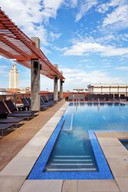 The pool and deck include impressive views of the UT campus.