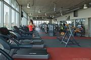 The fitness and wellness center includes dozens of pieces of equipment, all with panoramic views of the outdoors. Windows on both ends open up to create a breezeway when weather allows.