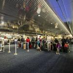 How many Thanksgiving travelers will go through Mitchell airport?