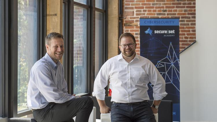SecureSet co-founder Bret Fund with managing partner and CTO Alex Kreilein. Fund estimates there are 12,000 open cybersecurity jobs in Colorado.