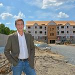 Rosetti building upscale condos, apartments off Route 9 in Colonie
