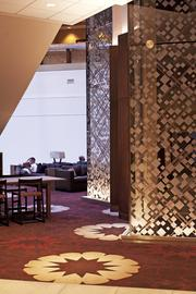 The lobby area's elevators and carpeting sport new designs and colors.