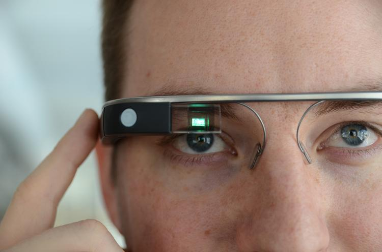 Jim Powell, director of technology for Purple Rock Scissors, operates a pair of Google Glass.