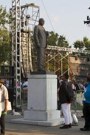 The statue of Martin Luther King Jr. stands behind the stage while the Trinity Broadcasting Network holds a concert Wednesday evening at Kelly Ingram Park.