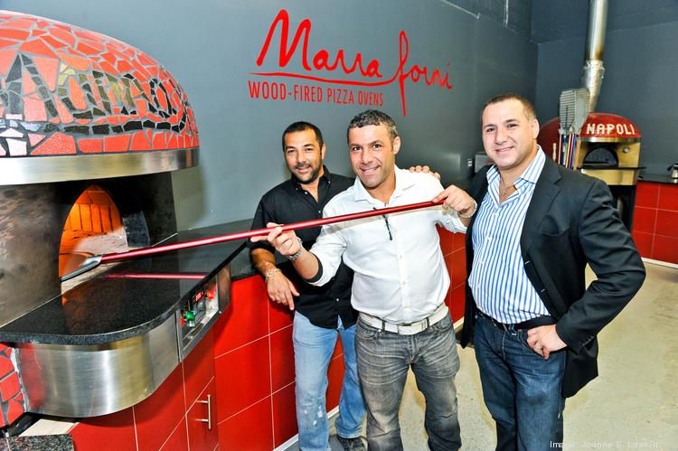 The pizza ovens built by brothers, from left, Enzo, Emiliano and Francesco Marra found their way inside such local restaurants as Ovvio Osteria and Italian Market & Deli.