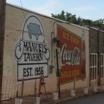 Coca-Cola sign at Manuel's Tavern being restored this week