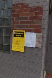 A notice says the property is scheduled to be demolished next week.