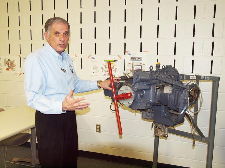 """Capt. Carmen """"Corkey"""" Romeo, director of CCBC's Aviation Sciences Program, explains how pilot trainees have to learn the insides and outsides of their airplanes."""
