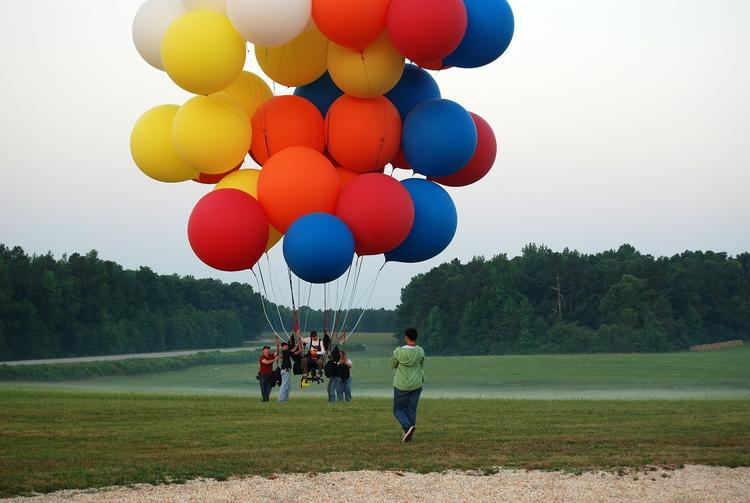Jonathan Trappe launches from a Franklin County airfield for his first cluster balloon flight in 2008 – using his office chair as a gondola.