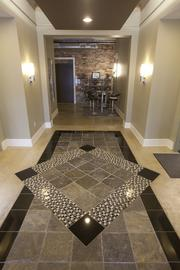 Custom tiles greet visitors when they walk into the lobby.