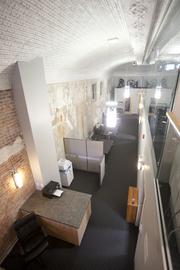 Building still sports some of the original tin ceiling and exposed brick walls.