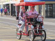 A couple takes a ride down the Boardwalk in Ocean City.