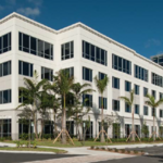 Newly built office building lands its first tenants, including recently acquired company
