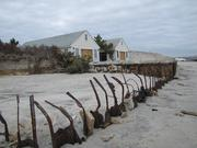 As seen in November 2012, a private residence seemed on the verge of being washed away by Sandy. Its windows were boarded up.
