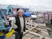 As seen in November 2012, Pirates Cove Marina owner Arthur Weller stands in front of a dock damaged by Sandy.