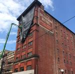 ​Why is there a net hanging over downtown's former Dennison Hotel?