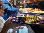 Third Street Social serves a variety of menu items, including crispy fried brussels.