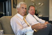 Umpqua Bank CEO Ray Davis, left, with Sterling Bank CEO Greg Seibly.