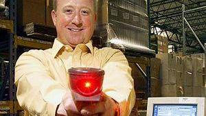A bar code scanner gun is the weapon of choice for Smart Warehousing CEO Carl Wasinger (pictured in this 2004 file photo).