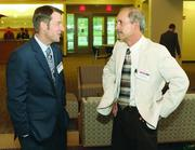 Dale Malloy of Fifth Third Bank and Frank Berchin of SE Technologies LLC.