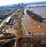The marina boat docks and the apartment building are shown in an aerial photo looking toward downtown Louisville.