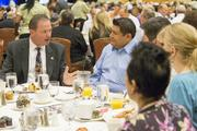 Scottsdale Mayor Jim Lane talks to friends at the table during the event.