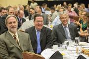 From left to right, Tom Franz of Greater Phoenix Leadership, Grady Gammage of Gammage & Burnham and Joe Gysel of EPCOR Water (USA) Inc. listen to a speaker at the event.