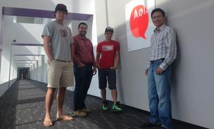 Ryan Shank, left, and colleagues on the Mhelpdesk team, which works out of AOL's Fishbowl Labs accelerator in Virginia.