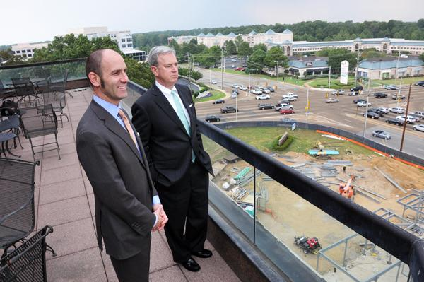 Jeff Smith and James McLaren on the balcony of the Crescent Center where their law firm is.