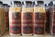 Knight's Popcorn also packages its unpopped product in containers.