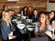 A birthday lunch for Kaitlin, seated at the head of the table.