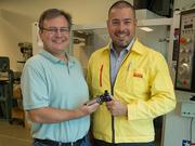John Deibert (left) mechanical and industrial engineering laboratory manager at SIUE, and Jay Stephens, territory productivity engineer with the Sandvik Coromant Co. Stephens presented a donation of tooling equipment to SIUE valued at nearly $4,000.