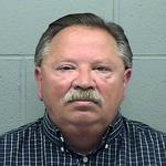 Halstead's administrator, former police chief arrested