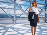 Tyneeha Rivers, director of  human resources  for the Philadelphia 76ers, on the roof of the business operations facility that is under construction  at the team's training complex in Camden.