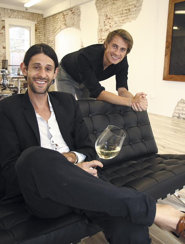 Chance Carpenter, seated, founder and creative director of Silhouette, and Andrew Paquin, his new art director, relax in their Hotel Street studio in Chinatown.