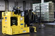 Once it's ready to go, an automated truck loader picks up pallets in the warehouse area of the plant for shipping.
