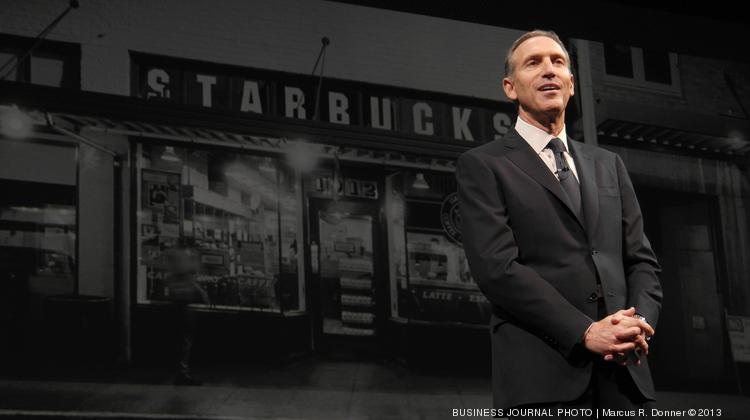 Starbucks CEO Howard Schultz speaks at the company's 2013 annual shareholders meeting at McCaw Hall in Seattle.