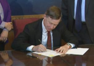 Colorado Gov. John Hickenlooper signs a trio of gun bills at the state Capitol in Denver on Wednesday, March 20, 2013.