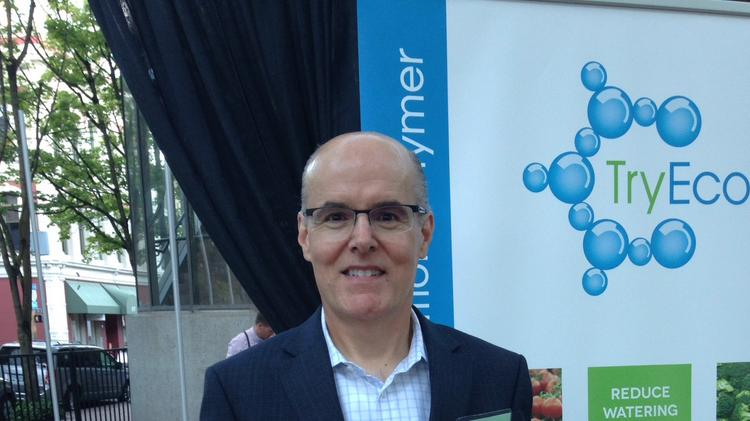 TryEco President Steve Jennings holds his Cascadia CleanTech grand prize and growth awards for $10,000.