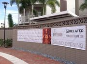 Sign for opening of Channel District's newest apartments.