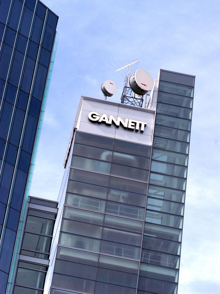 Gannett says it bought Belo for $13.75 per share in cash, plus the assumption of $715 million of outstanding debt.