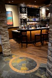 A belt buckle tile design leads into the new bar area.