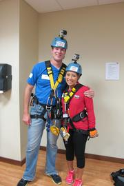 """Chip Brewster and Angelica Duria of Business Journal news partner WITI-TV """"Fox 6 News"""" in their safety gear."""
