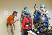 Hills checks to make sure everyone is ready to rappel down the side of the building safely.