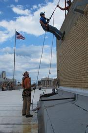 Brewster gets a training run before rappelling down the side of the City Center.
