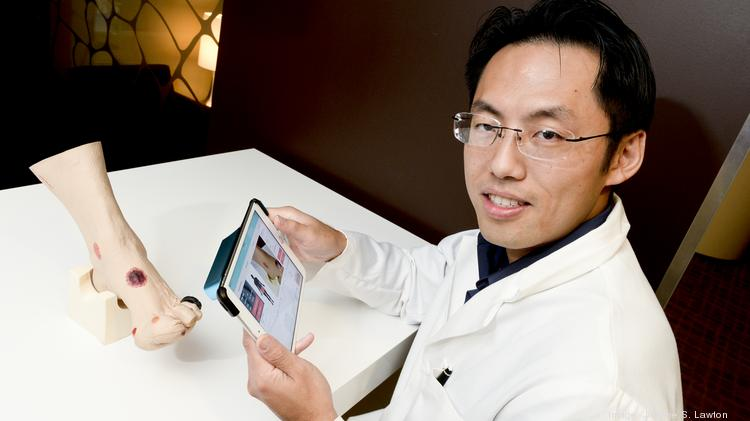 Kyle Wu left his surgical training to form a startup that can assess a wound just by taking a picture on an iPad.