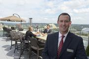 Jason Druso, general manager of the Residence Inn, stands at the Top of the Park rooftop terrace.